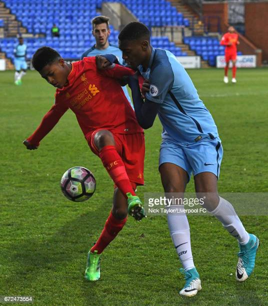 Rhian Brewster of Liverpool and Tosin Adarobioyo of Manchester City in action during the Liverpool v Manchester City Premier League 2 game at Prenton...