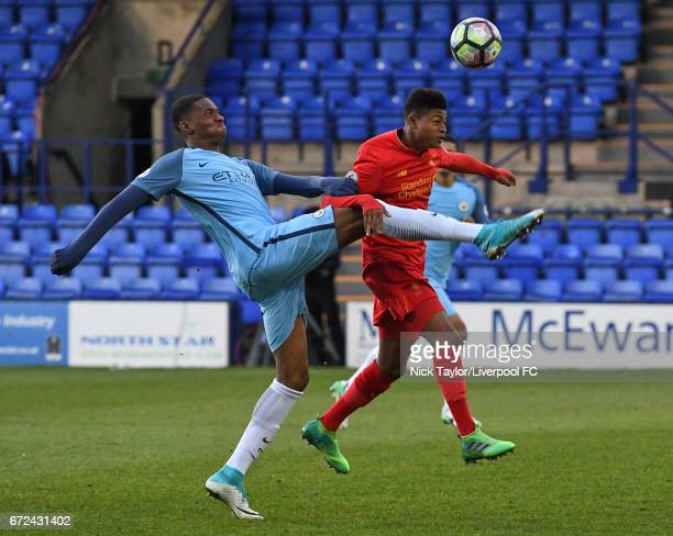 Rhian Brewster of Liverpool and Tosin Adorabioyo of Manchester City in action during the Liverpool v Manchester City Premier League 2 game at Prenton...