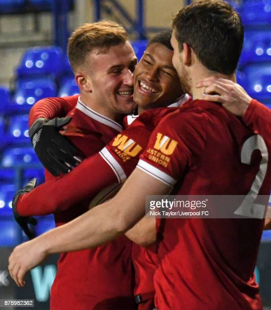 Rhian Brewster of Liverpool celebrates scoring with team mates Herbie Kane and Jon Flanagan during the Liverpool v Everton Premier League 2 game at...