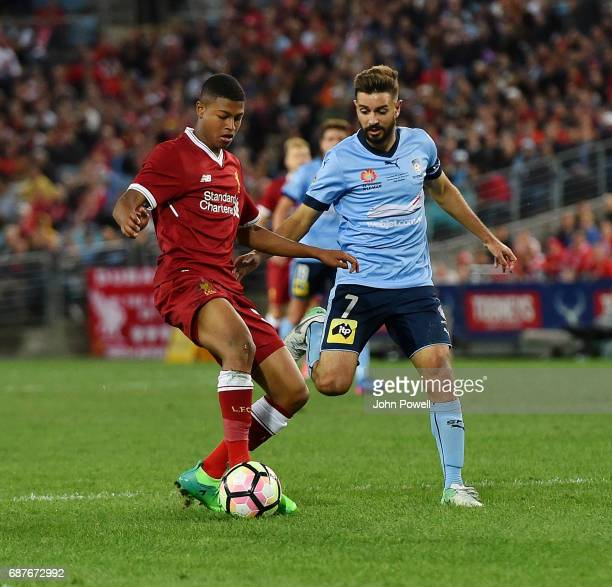 Rhian Brewster of Liverpool competes with Michael Zullo of Sydney FC during the International Friendly match between Sydney FC and Liverpool FC at...