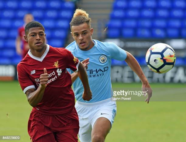 OUT Rhian Brewster of Liverpool with Joel Latibeaudiere of Manchester City during the game at Prenton Park on September 10 2017 in Birkenhead England