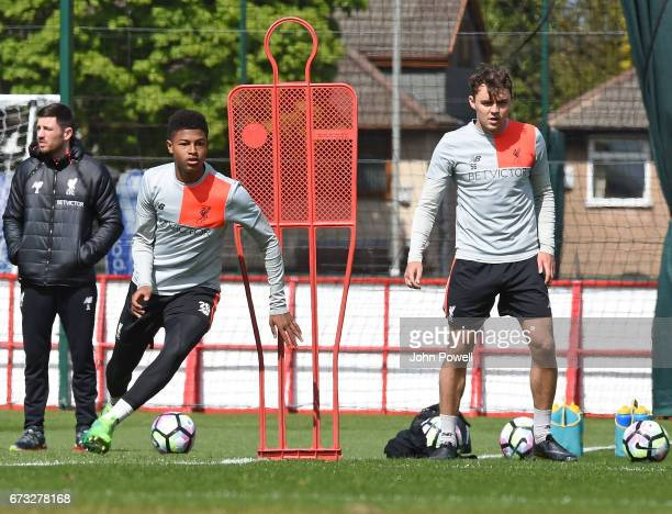 Rhian Brewster with Connor Randall of Liverpool during a training session at Melwood Training Ground on April 26 2017 in Liverpool England