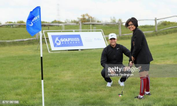 Rhianna Patel is watched by Lucas Bjerregaard during a Golf Foundation GolfSixes Academy event at prior to the start of GolfSixes at The Centurion...