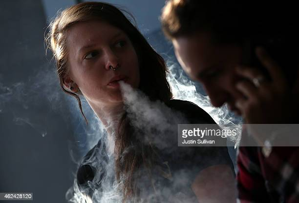 Rhiannon GriffithBowman smokes an ECigarette at Digita Ciggz on January 28 2015 in San Rafael California The California Department of Public Health...