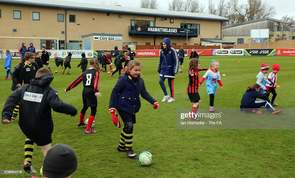 Rhianon Gray development player for Sunderland Ladies, coaches children before the WSL 1 match between Sunderland AFC Ladies and Manchester City Women at The Hetton Center on April 29, 2016 in Hetton, England.