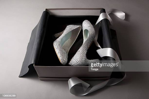 Rhinestone pair of shoes in shoe box