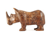 Rhinoceros rhino sculpture made of carved varnished brown wood isolated over white background