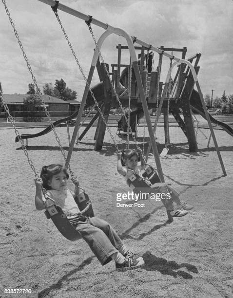 Rhoda Duran 2 1/2 And Darlene Rodriguez Play At Hallack Park The Hallack will giving the land to the city was recorded in 1961 Credit The Denver Post