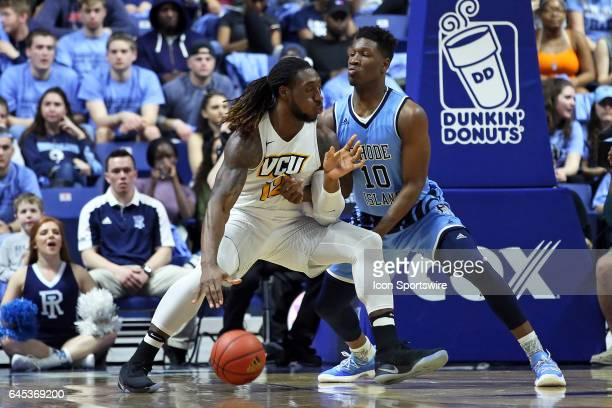 Rhode Island Rams forward Cyril Langevine defends VCU Rams forward Mo AlieCox during the first half of a college basketball game between VCU Rams and...