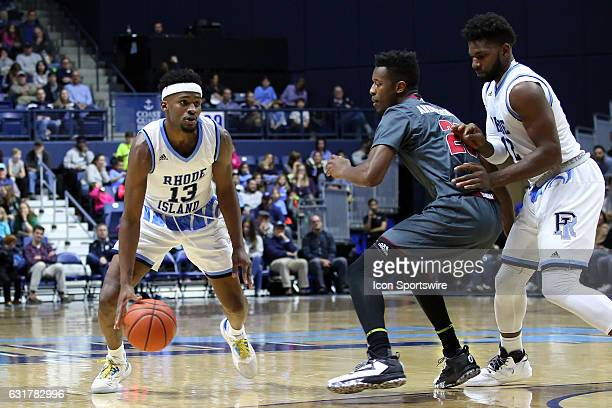 Rhode Island Rams forward Hassan Martin attempts to set a pick for Rhode Island Rams guard Stanford Robinson as he is defended by UMass Minutemen...