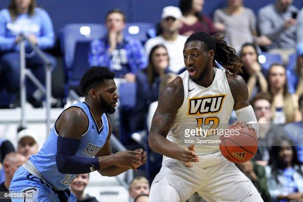 Rhode Island Rams forward Hassan Martin defends VCU Rams forward Mo AlieCox during the first half of a college basketball game between VCU Rams and...