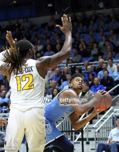 Rhode Island Rams guard Christion Thompson pump fakes VCU Rams forward Mo AlieCox during the first half of a college basketball game between VCU Rams...