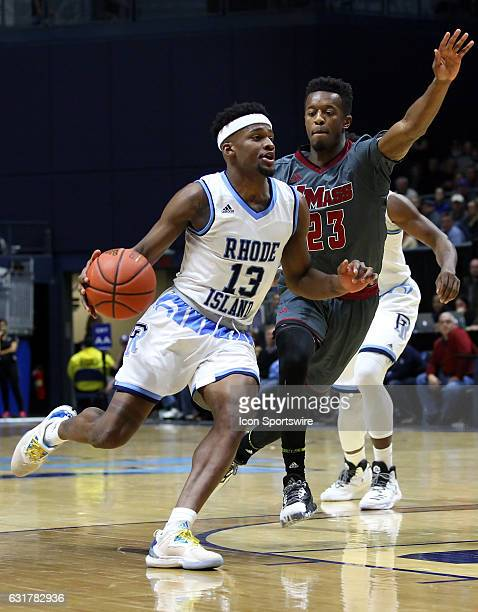 Rhode Island Rams guard Stanford Robinson drives past UMass Minutemen guard CJ Anderson during the first half of an NCAA basketball game between...