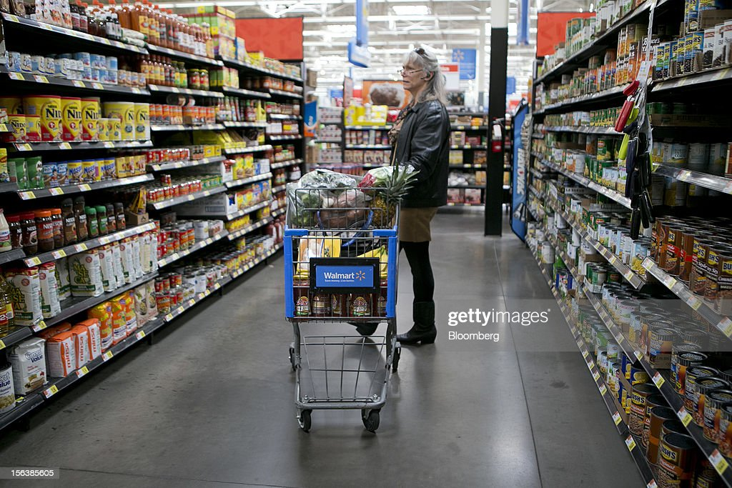 Rhodessa Bender shops in the grocery section at a Wal-Mart store in Alexandria, Virginia, U.S., on Wednesday, Nov. 14, 2012. Wal-Mart Stores Inc. is scheduled to release earnings data on Nov. 15. Photographer: Andrew Harrer/Bloomberg via Getty Images