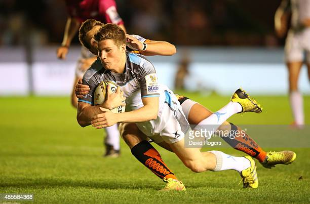 Rhodri Adamson of Newcastle Falcons scores a try against Exeter Chiefs during the Singha Premiership Rugby 7's Series finals at Twickenham Stoop on...