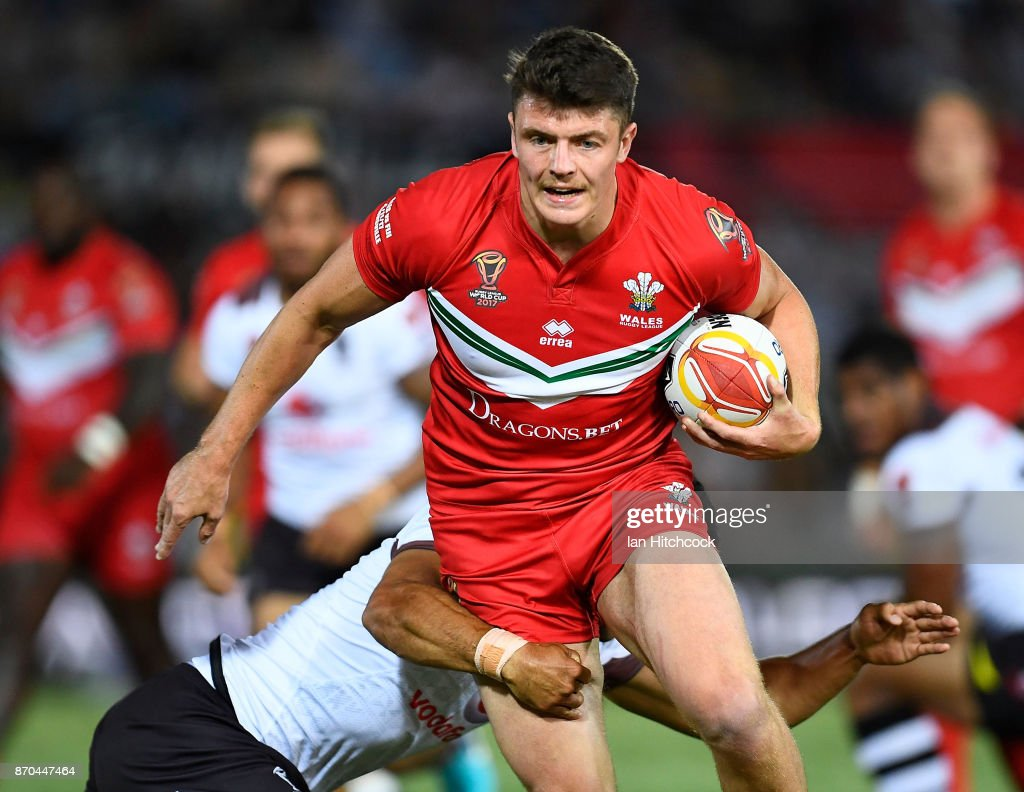 Rhodri Lloyd of Wales skips out of a tackle of Jarryd Hayne of Fiji during the 2017 Rugby League World Cup match between Fiji and Wales at 1300SMILES Stadium on November 5, 2017 in Townsville, Australia.