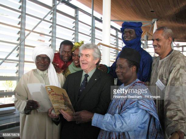 Rhodri Morgan receives a book on the history of Timbuktu from First Mayor of Timbuktu Said Ould Mahmoud and the Malian ambassador to Belgium Ibrahim...