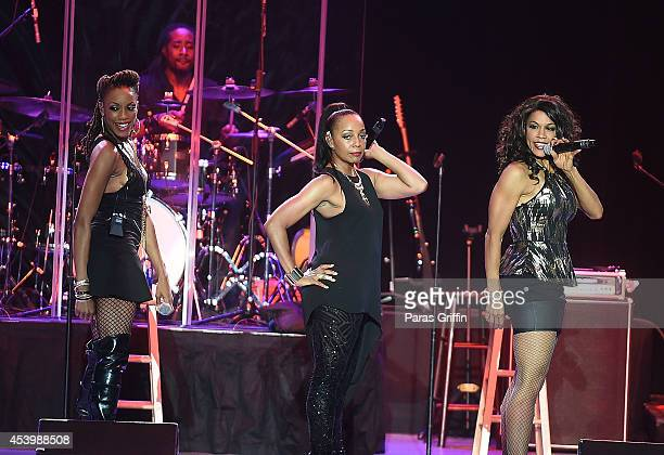 Rhona Bennett Terry Ellis and Cindy Herron of En Vogue perform in concert at Chastain Park Amphitheater on August 22 2014 in Atlanta Georgia