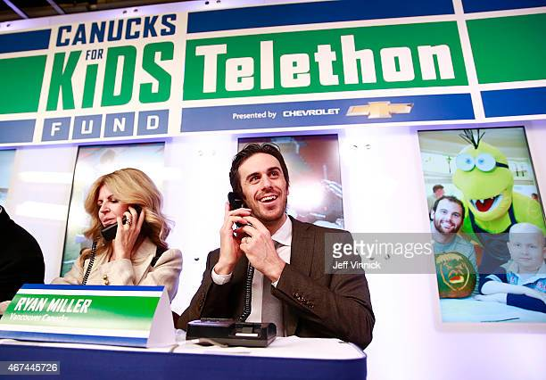 Rhonda Desjardins wife of head coach Willie Desjardins of the Vancouver Canucks and injured Canucks' goaltender Ryan Miller take calls on the Canucks...