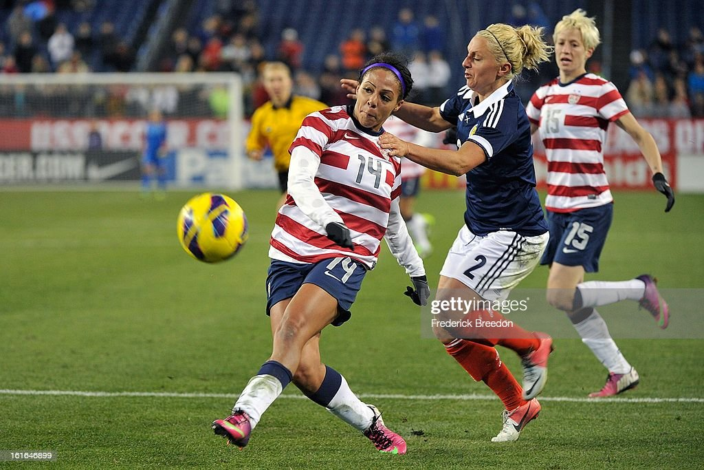 Rhonda Jones #2 of the Scotland Women's National Team plays against <a gi-track='captionPersonalityLinkClicked' href=/galleries/search?phrase=Sydney+Leroux&family=editorial&specificpeople=5760664 ng-click='$event.stopPropagation()'>Sydney Leroux</a> #14 of the U.S. Women's National Team at LP Field on February 13, 2013 in Nashville, Tennessee.