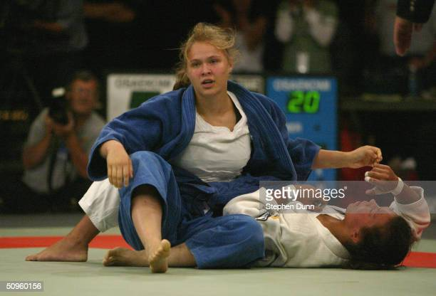 Rhonda Rousey and Anastasia Krivosta compete in their 63 kg match during the US Olympic Team Trials in Judo at the San Jose State University Event...