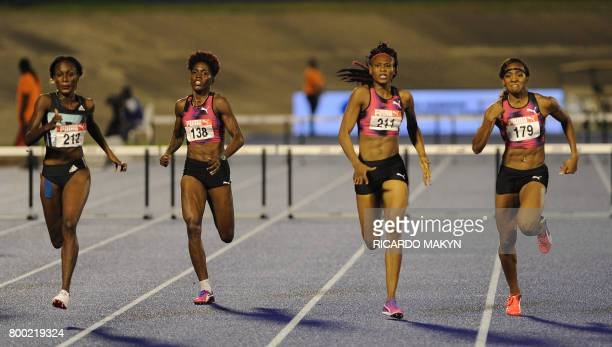 Ronda Whyte winner fourth place finisher Janieve Russell Ristanana Tracey second place and Leah Nugent third place race in the women's 400m hurdles...