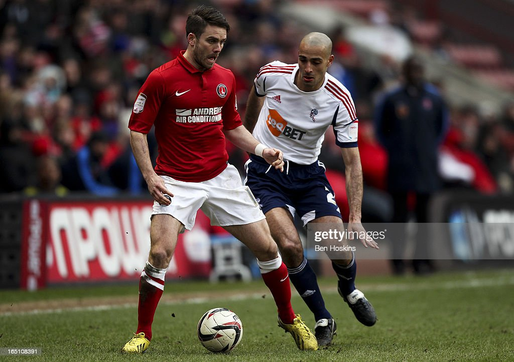 Rhoys Wiggins of Charlton holds off pressure from Darren Pratley of Bolton during the npower Championship match between Charlton Athletic and Bolton Wanderers at the Valley on March 30, 2013 in London, England.