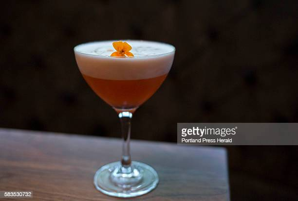 Rhubarb Sour made with Hendricks Gin Aperol lemon egg white simple syrup and bitters at The Velveteen Habit in Cape Neddick