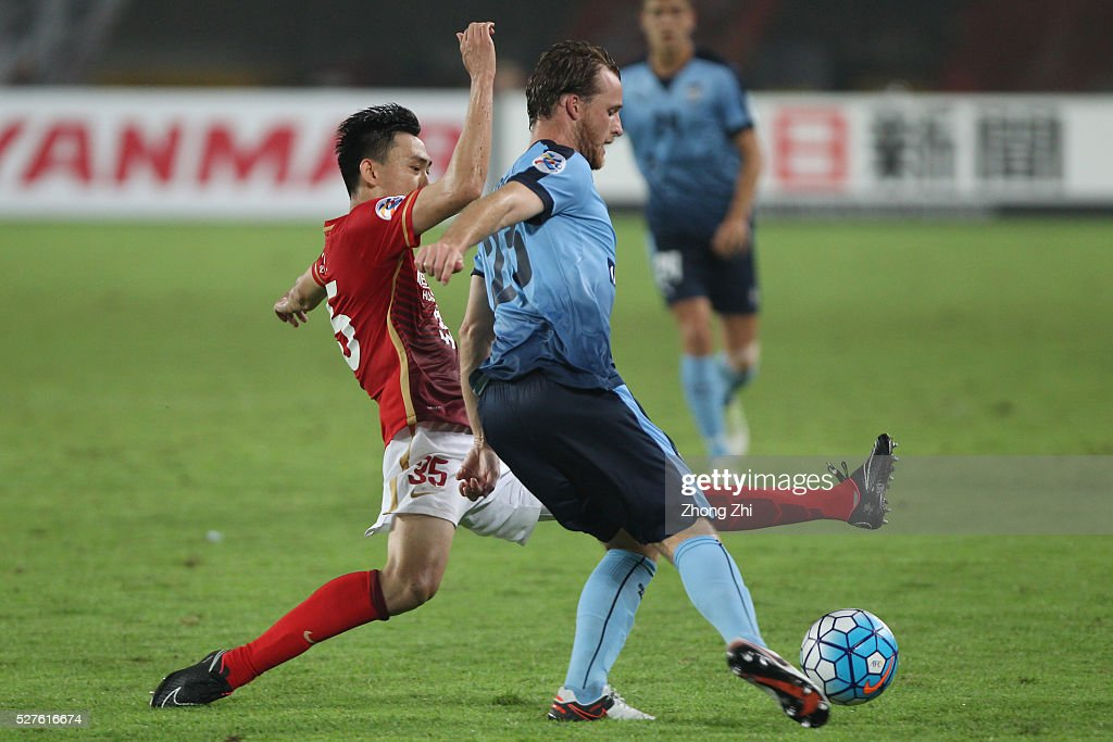 Rhyan Bert Grant of Sydney FC in action against Li Xuepeng of Guangzhou Evergrande during the AFC Asian Champions League match between Guangzhou Evergrande FC and Sydney FC at Tianhe Stadium on May 3, 2016 in Guangzhou, China.