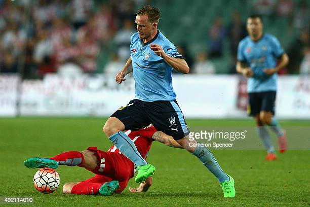 Rhyan Grant of Sydney FC and Aaron Mooy of Melbourne City FC contest the ball during the round one ALeague match between Sydney FC and Melbourne City...