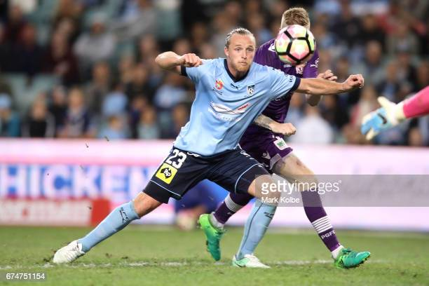 Rhyan Grant of Sydney FC and Andy Keogh of the Glory compete for the ball in front of goal during the ALeague Semi Final match between Sydney FC and...