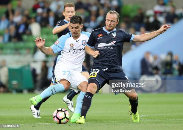 Rhyan Grant of Sydney FC and Bruno Fornaroli of City compete for the ball during the round 21 ALeague match between Melbourne City and Sydney FC at...