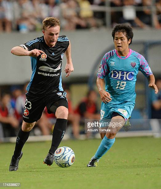 Rhyan Grant of Sydney FC and Shoei Okada of Sagan Tosu in action during the preseason friendly match between Sagan Tosu and Sydney FC at best Amenity...