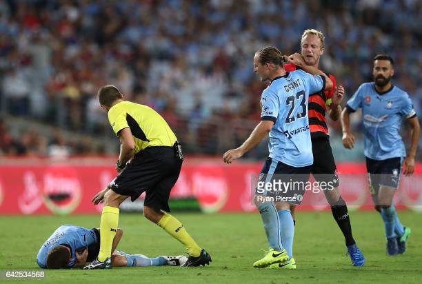 Rhyan Grant of Sydney FC clashes with Mitch Nichols of the Wanderers after Brandon O'Neill of Sydney FC clashed with Kearyn Baccus of the Wanderers...