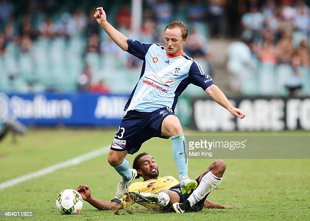 Rhyan Grant of Sydney FC is challenged by Isaka Cernak of the Mariners during the round 18 ALeague match between Sydney FC and the Central Coast...