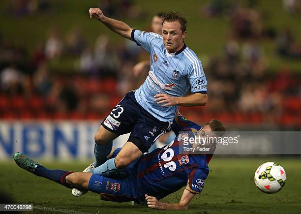 Rhyan Grant of Sydney FC is tackled by Andrew Hoole of the Jets during the round 26 ALeague match between the Newcastle Jets and the Sydney FC at...