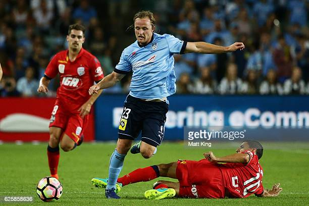 Rhyan Grant of Sydney FC is tackled by Marcelo Carrusca of United during the round eight ALeague match between Sydney FC and Adelaide United at...