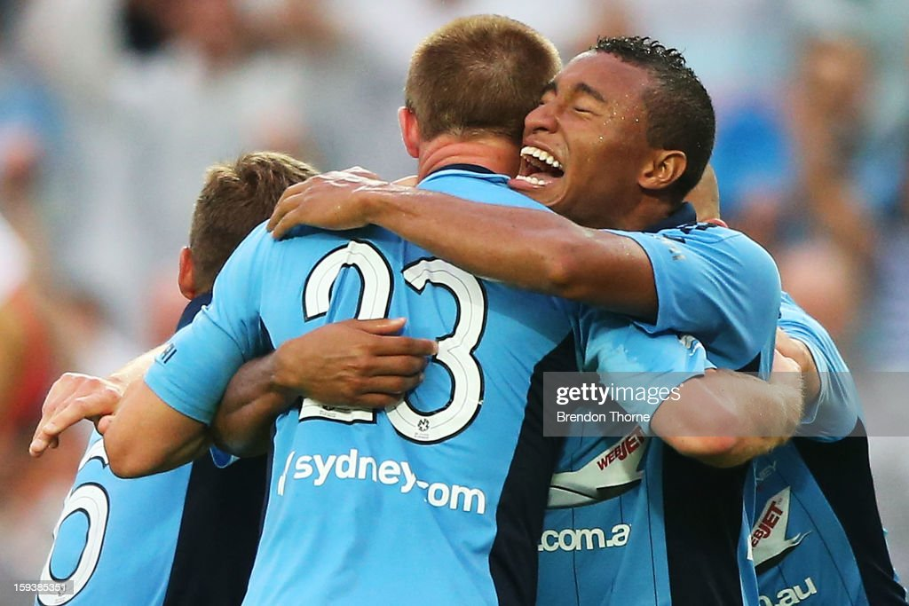 Rhyan Grant of Sydney is hugged by team mate Yairo Yau after scoring the winning goal in extra time during the round 16 A-League match between Sydney FC and the Melbourne Heart at Allianz Stadium on January 13, 2013 in Sydney, Australia.