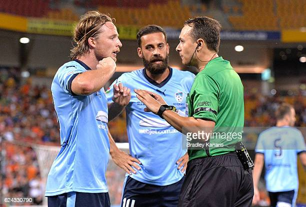 Rhyan Grant of Sydney is warned by referee Alan Milliner during the round seven ALeague match between the Brisbane Roar and Sydney FC at Suncorp...