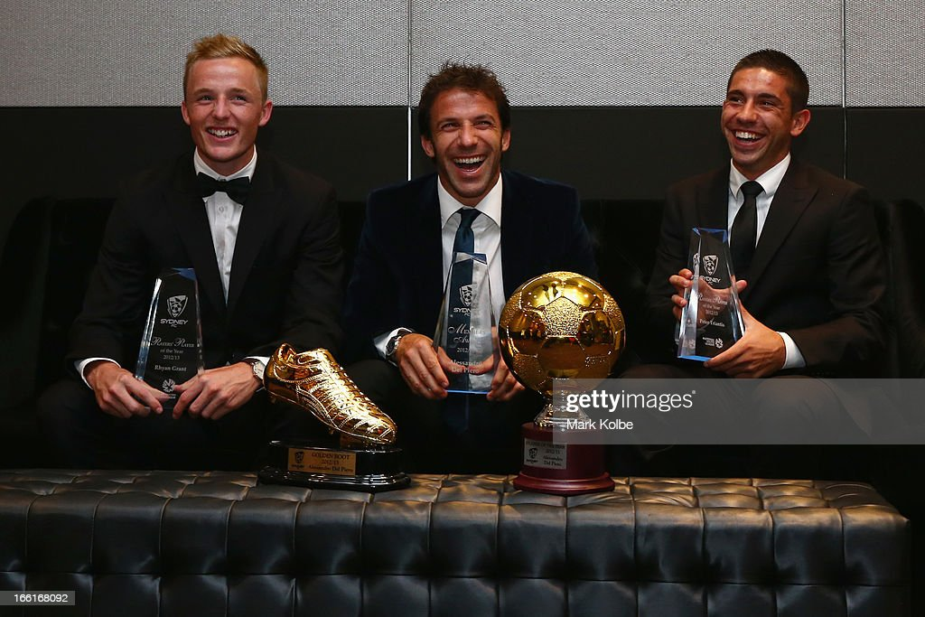 Rhyan Grant posing with the Sydney FC A-League Players' Player of the Year award, <a gi-track='captionPersonalityLinkClicked' href=/galleries/search?phrase=Alessandro+Del+Piero&family=editorial&specificpeople=206226 ng-click='$event.stopPropagation()'>Alessandro Del Piero</a> posing with the Golden Boot Award, the Sydney FC Members Award and the 2012/13 Sydney FC Player of the Year Award and Peter Triantis posing with the Sydney FC Youth League Players' Player of the Year share a laugh at the Sydney FC Sky Blue Ball at Doltone House on April 9, 2013 in Sydney, Australia.
