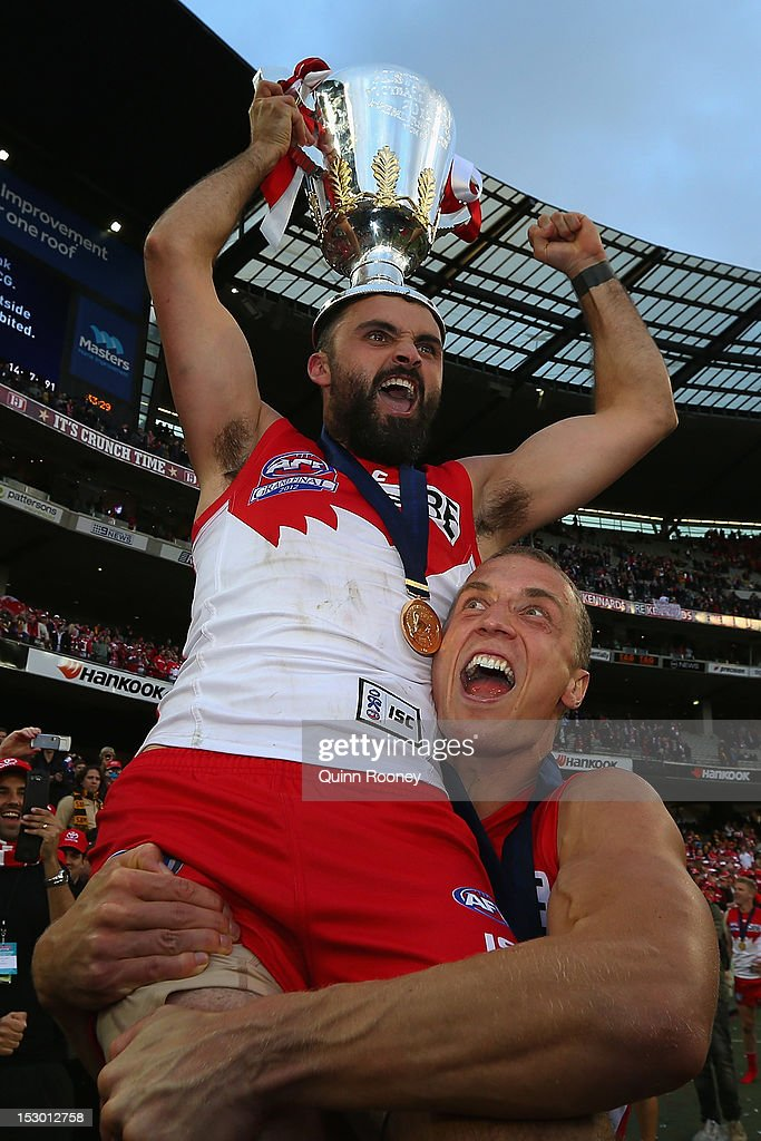 Rhyce Shaw and Ted Richards of the Swans celebrate with the Premiership Cup after Sydney won the 2012 AFL Grand Final match between the Sydney Swans and the Hawthorn Hawks at the Melbourne Cricket Ground on September 29, 2012 in Melbourne, Australia.