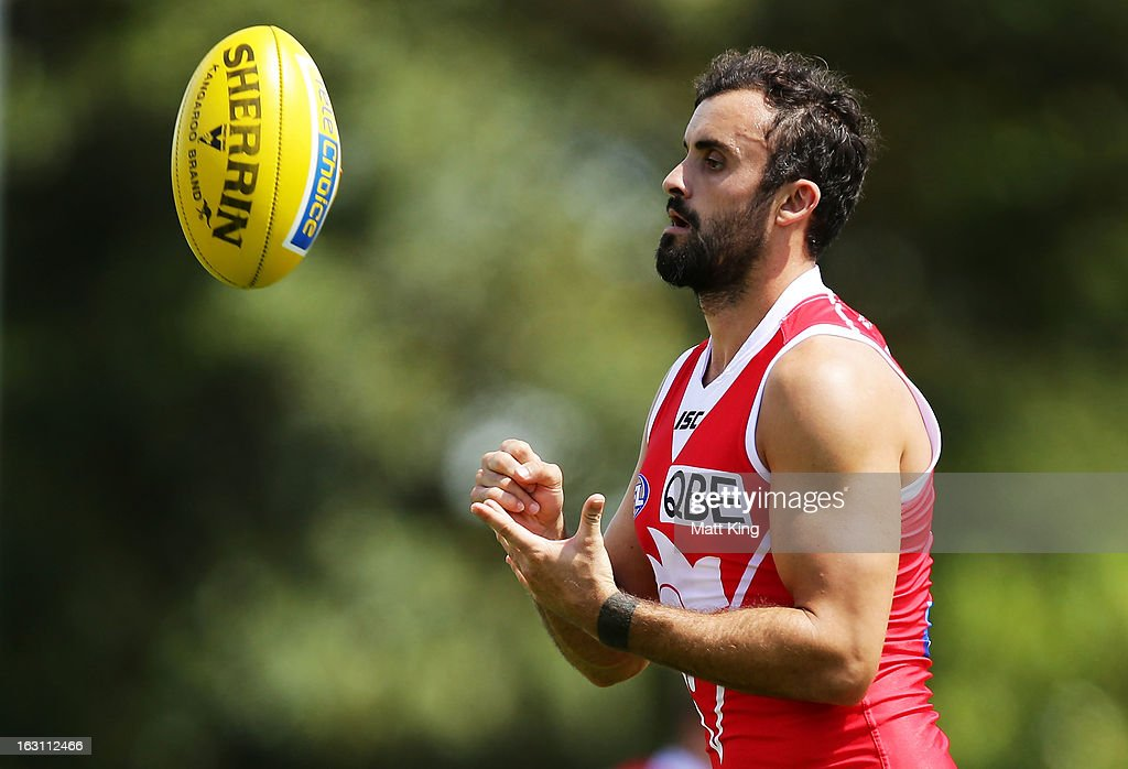 <a gi-track='captionPersonalityLinkClicked' href=/galleries/search?phrase=Rhyce+Shaw&family=editorial&specificpeople=239017 ng-click='$event.stopPropagation()'>Rhyce Shaw</a> completes a drill during a Sydney Swans AFL training session at Lakeside Oval on March 5, 2013 in Sydney, Australia.