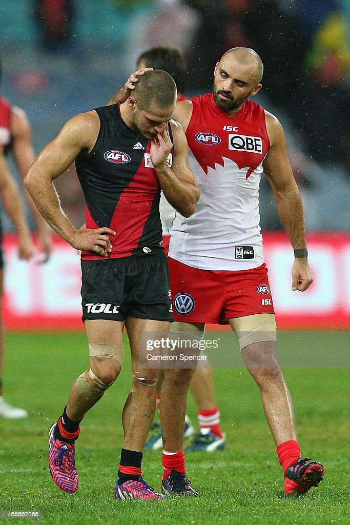 Rhyce Shaw of the Swans embraces David Zaharakis of the Bombers following Swans win in the Round One AFL match between the Sydney Swans and the Essendon Bombers at ANZ Stadium on April 4, 2015 in Sydney, Australia.