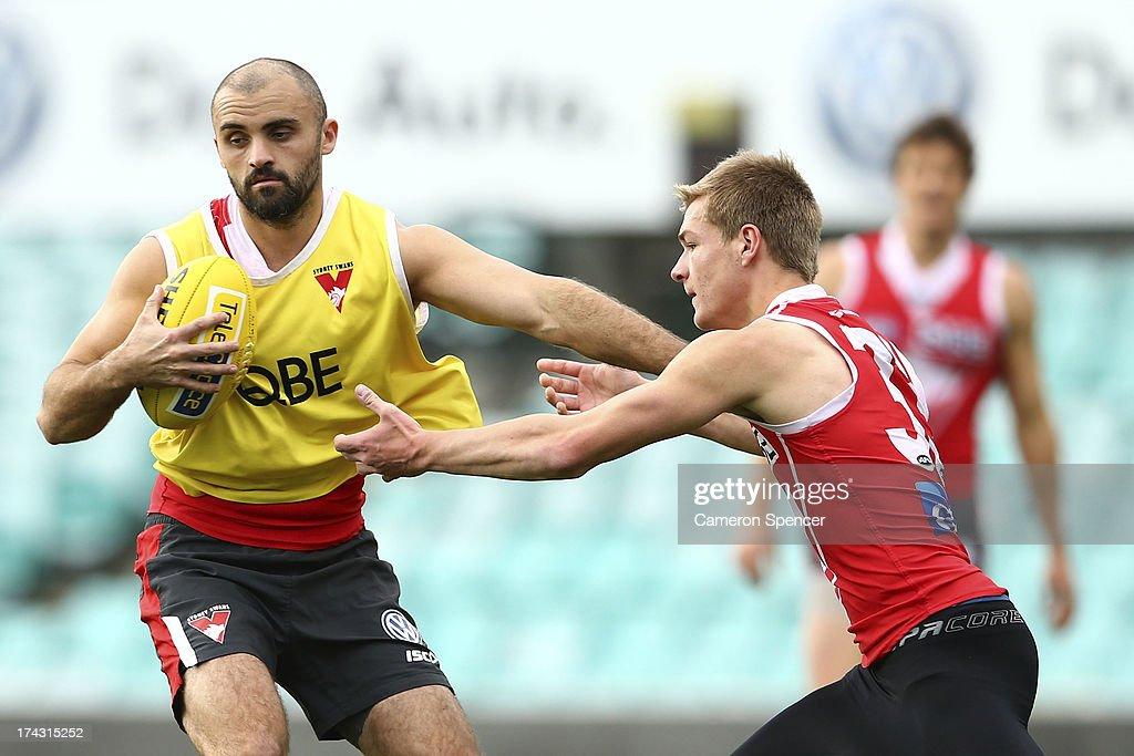 Rhyce Shaw of the Swans is tackled by Brandon Jack of the Swans during a Sydney Swans AFL training session at Sydney Cricket Ground on July 24, 2013 in Sydney, Australia.
