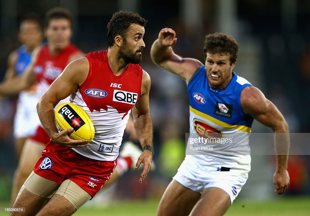 Rhyce Shaw of the Swans wins the ball over Campbell Brown of the Suns during the round three NAB Cup AFL match between the Sydney Swans and the Gold Coast Suns at Blacktown International Sportspark on March 9, 2013 in Sydney, Australia.