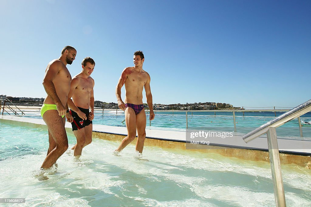 Rhyce Shaw, Tom Mitchell and Andrejs Everitt leave the pool during a Sydney Swans AFL recovery session at Bondi Icebergs Pool on August 5, 2013 in Sydney, Australia.