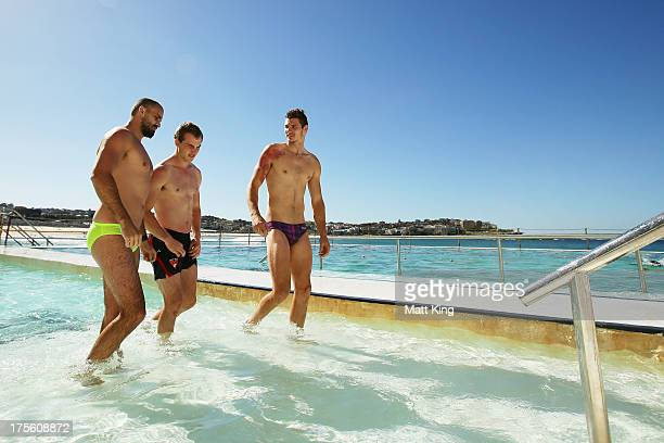 Rhyce Shaw Tom Mitchell and Andrejs Everitt leave the pool during a Sydney Swans AFL recovery session at Bondi Icebergs Pool on August 5 2013 in...