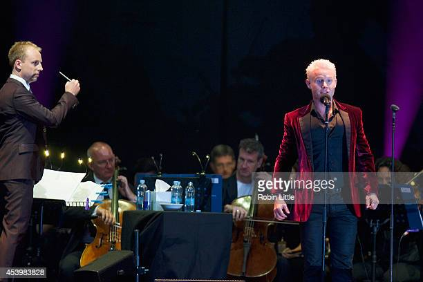 Rhydian performs on stage with The Royal Philharmonic Orchestra at Greenwich Music Time at the Old Royal Naval College on August 22 2014 in Greenwich...