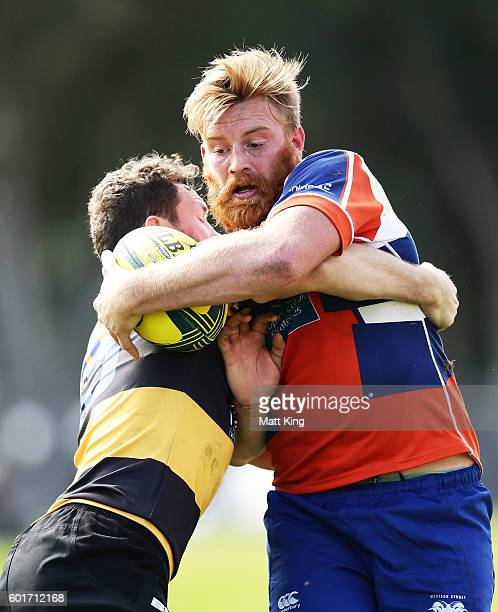 Rhys Allen of the Rams is tackled during the round three NRC match between the Western Sydney Rams and the Perth Spirit at Concord Oval on September...