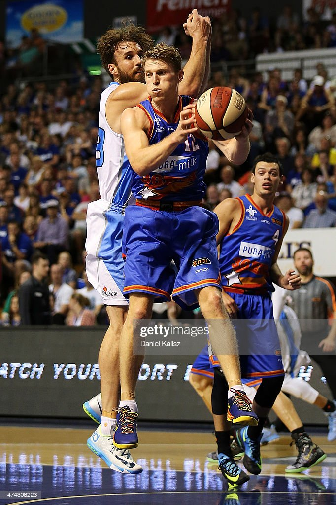 Rhys Carter of the Sixers contests for the ball during the round 19 NBL match between the Adelaide 36ers and the New Zealand Breakers at Adelaide Arena in February 23, 2014 in Adelaide, Australia.